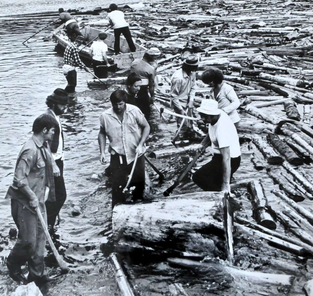 Log drive workers including David Calder of Canaan prepare to move floating logs piled up near The Great Eddy on the Kennebec River in Skowhegan in the 1970s.