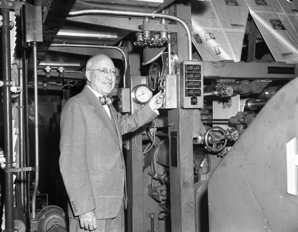 April 1948 : Guy P. Gannett, switching on new Hoe presses in Portland Press Herald pressroom.