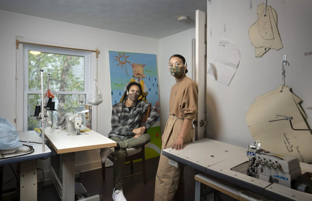 Jordan Carey, left, and Madison Poitrast-Upton pose for a photo in their Portland design studio. The materials they use and the designs they create have the aim of empowering marginalized people and causes.