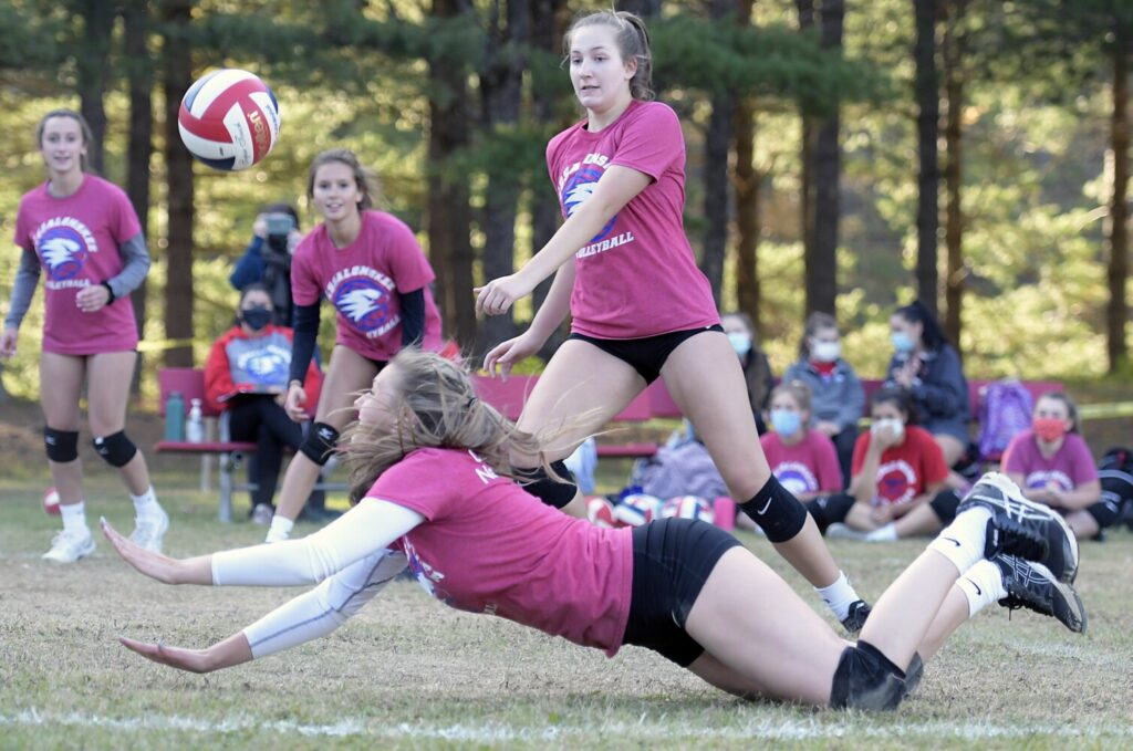 A Messalonskee volleyball player reaches for the ball during a an Oct. 5 game in Augusta. This fall was supposed to be the varsity debut of the Messalonskee volleyball team.