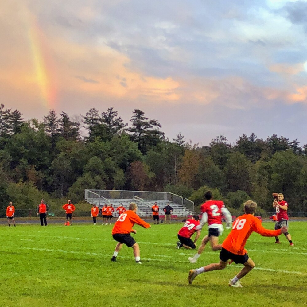 A rainbow glows over a 7-on-7  game between Cony and Gardiner on Oct. 2 at Alumni Field in Augusta.