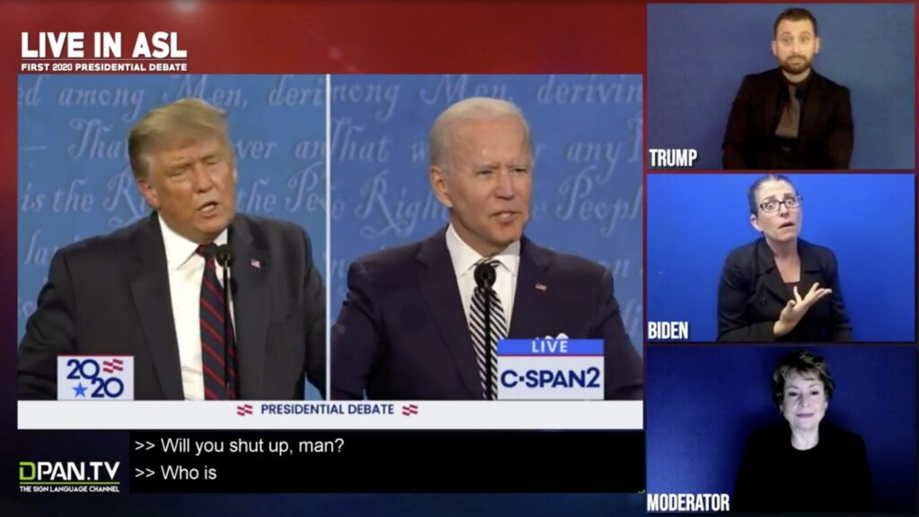 "American Sign Language interpreter Regan Thibodeau, right center, interprets Joe Biden telling President Trump, ""Will you shut up, man?"" during the presidential debate last week. This image is taken from a video broadcast on DPAN.TV."