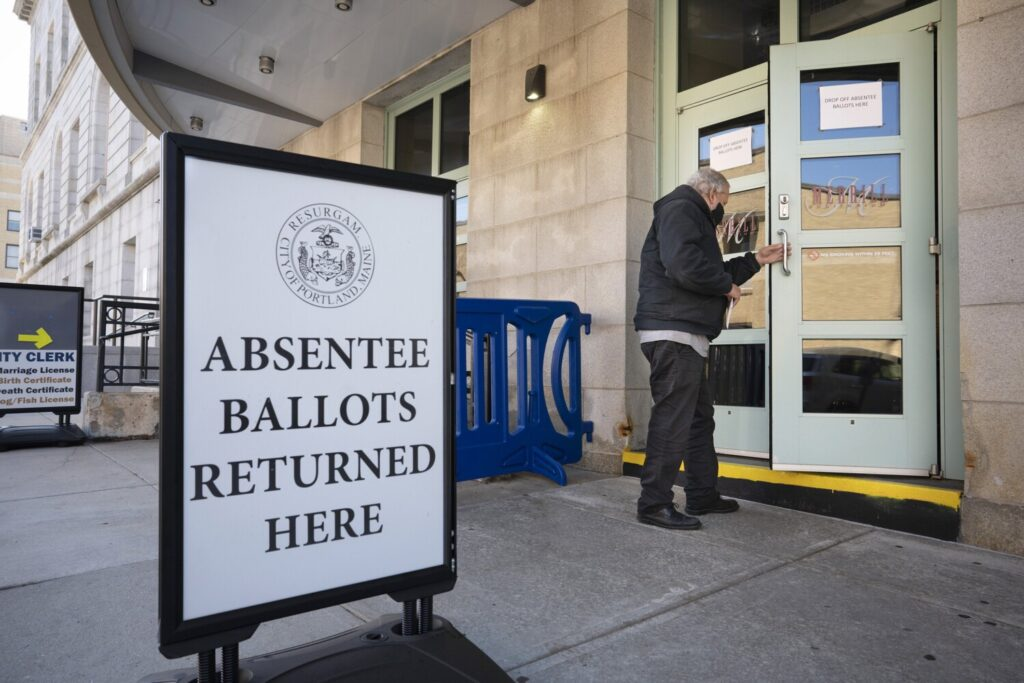 A man enters the lobby area of Merrill Auditorium in Portland to drop off his absentee ballot last October. Gregory Rec/Staff Photographer