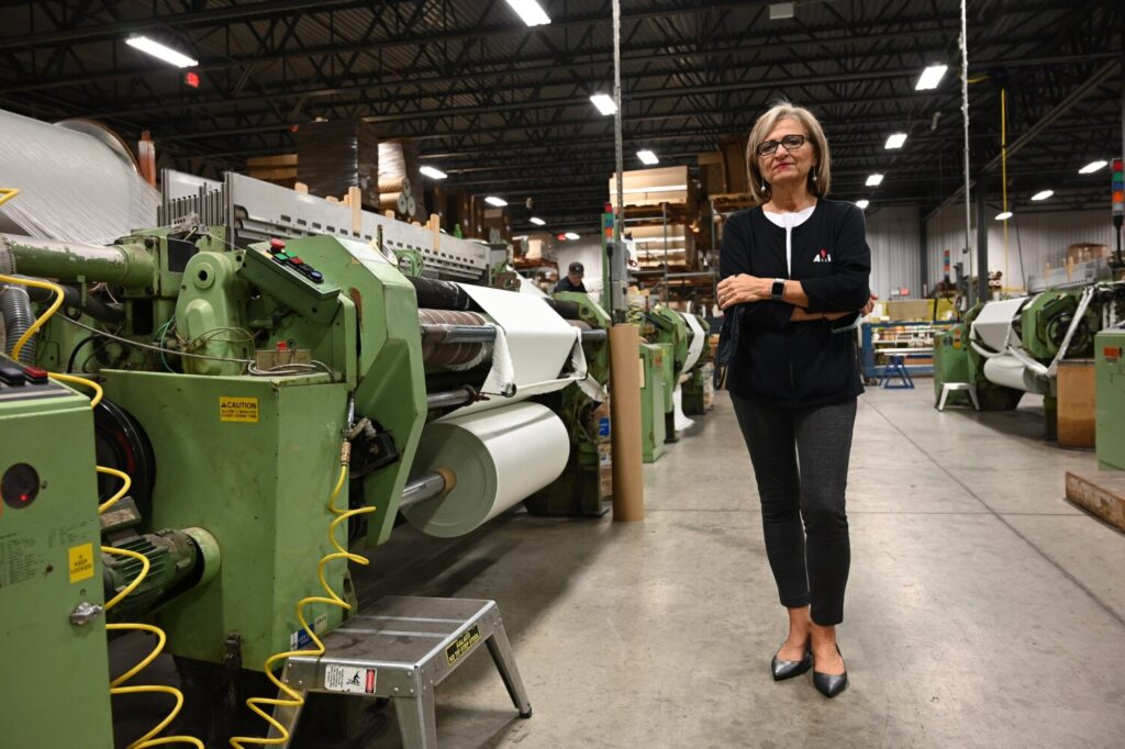 Auburn Manufacturing President and CEO Kathie Leonard stands in her manufacturing center in Auburn on Oct. 7. Leonard says a company at least partially owned by the president of Belarus is dumping flame-resistant silica fabric on the U.S. market, undercutting her prices.