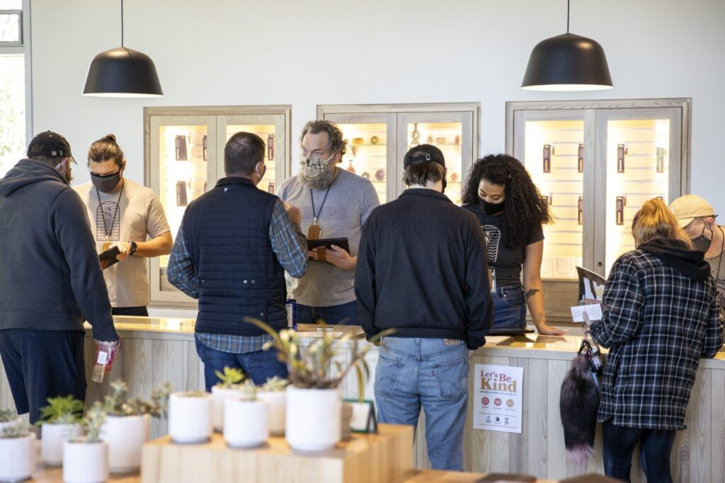 Budtenders help customers at SeaWeed Co. in South Portland  on the first day of recreational marijuana sales in October. Records show 21,194 sales made at six recreational marijuana stores licensed to do business in their first month of business.