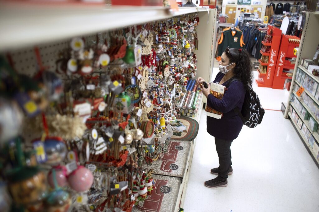 Elva Fuentes of Belvidere, Illinois, looks at holiday ornaments while shopping at Renys in Portland on Wednesday. Renys will continue its annual Early Bird sale, but this year will run it throughout that Saturday, Nov. 7.