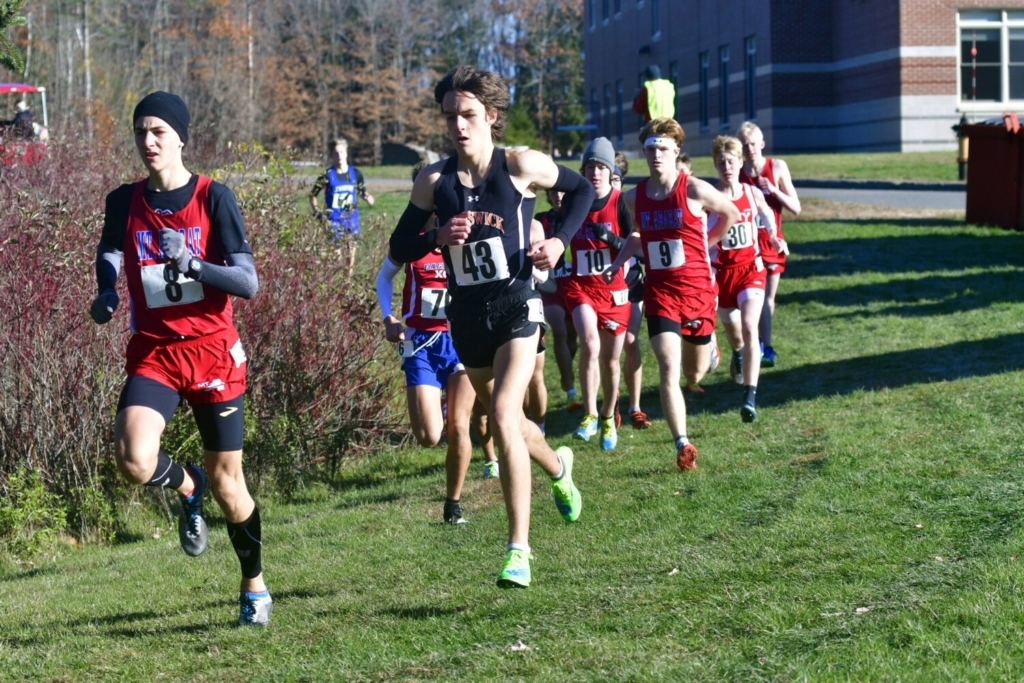 Mt. Ararat's Grady Satterfield (8) and Brunswick's Tyler Patterson get off to an early lead during the KVAC Class A cross country championship October 31 at Cony High School in Augusta. Patterson won in 16:46 and Satterfield was second in 16:58.