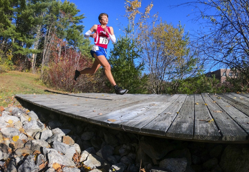 Messalonskee's Dylan Flewelling races during the KVAC Class A cross country championship Oct. 31 at Cony High School in Augusta.