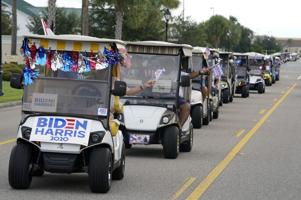 A parade of over 300 supporters of Democratic presidential candidate former Vice President Joe Biden caravanned to the Sumter County Elections office to cast their ballots during early voting Wednesday in The Villages, Fla.