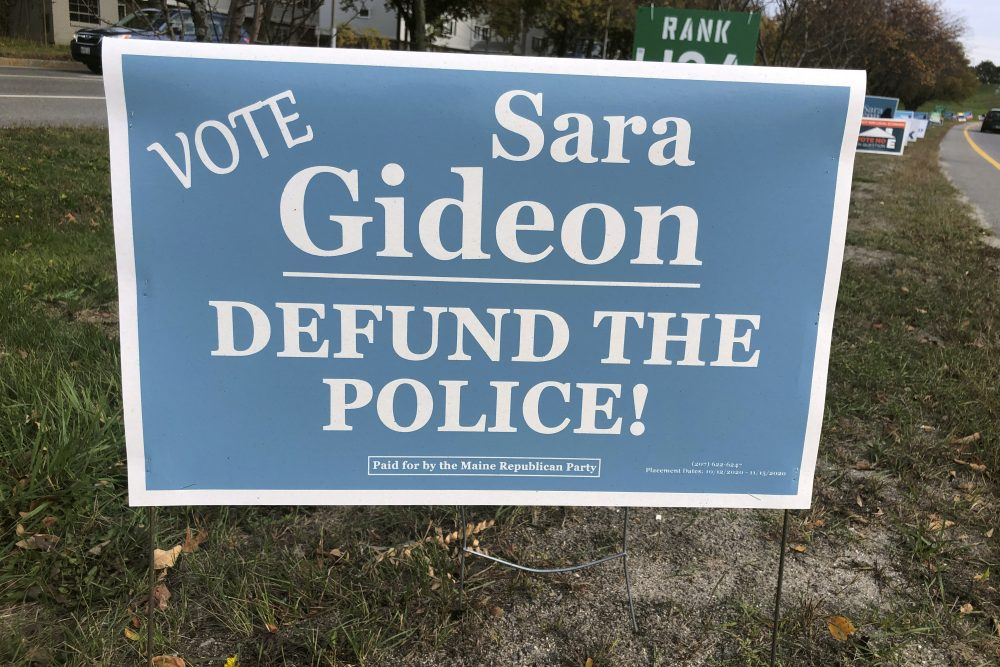 "The Maine Republican Party has put up signs claiming Democrat Sara Gideon wants to defund the police after ""Trump/Collins"" signs, paid for by Democrats, began appearing a few weeks ago. (AP Photo/David Sharp)"