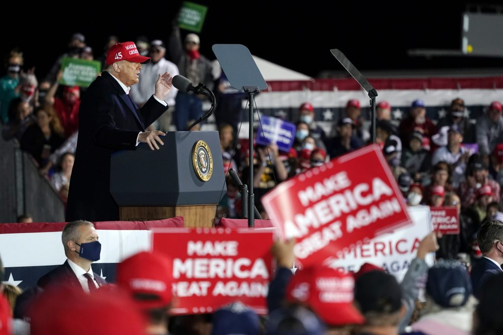 President Trump speaks at a campaign rally at Des Moines International Airport in Iowa on Wednesday. (AP Photo/Alex Brandon)