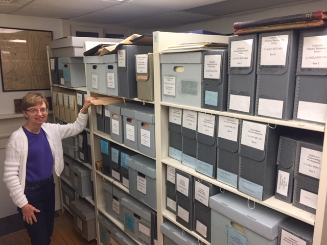 KHS Archivist Emily Schroeder surveys the vast collections to be inventoried.