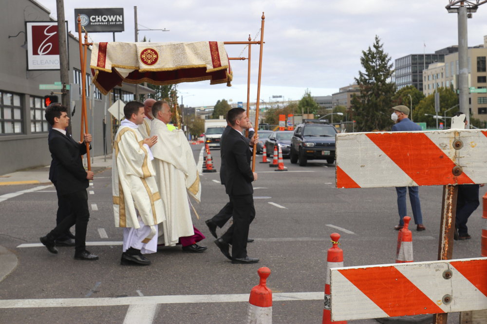 Archbishop Alexander Sample carries the Eucharist into downtown Portland, Ore., for an exorcism and rosary to bring peace and justice to the city on Oct. 17.