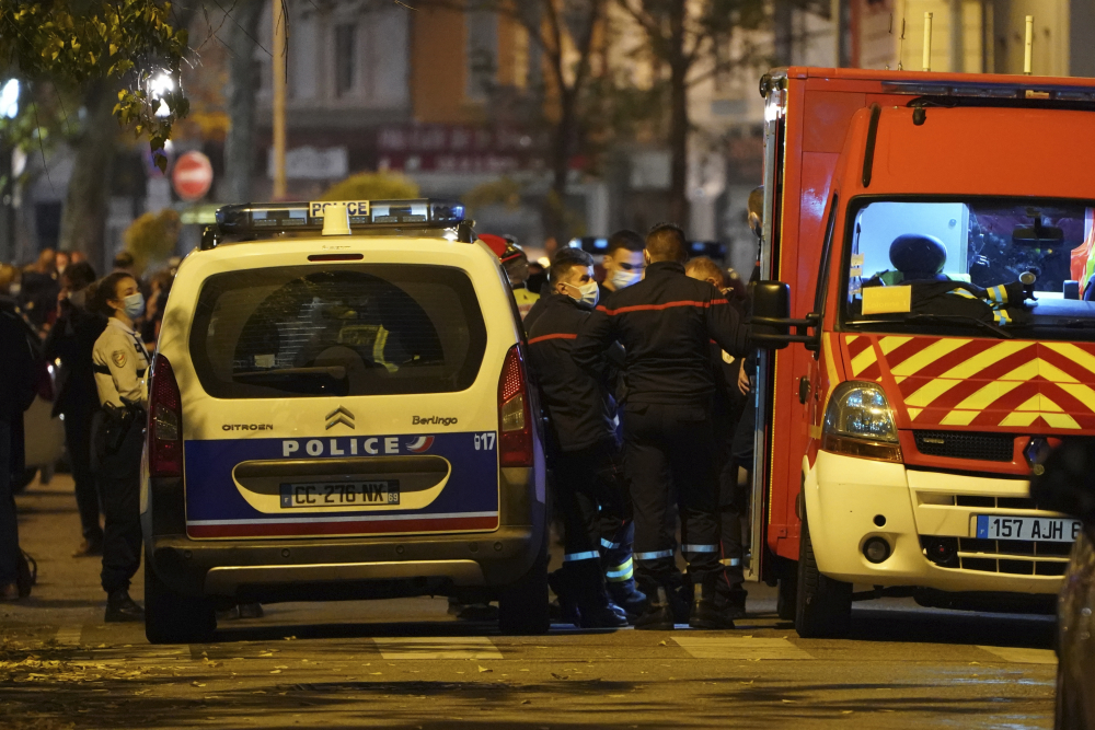 Police officers and rescue workers block access to the scene after a Greek Orthodox priest was shot Saturday while he was closing his church in the city of Lyon, central France. The priest, a Greek citizen, is in a local hospital with life-threatening injuries after being hit in the abdomen, a police official said.