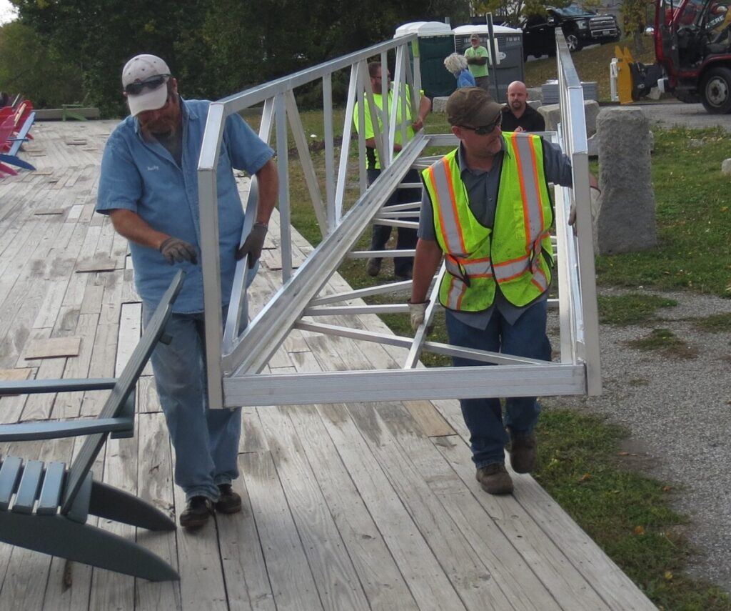 Hallowell Public Works Director Chris Buck, left, and Todd Tallon move the new bulkhead ramp into place with help from Tom Gorta, back left, and Hammond Lumber's Ryan Masse in the rear.