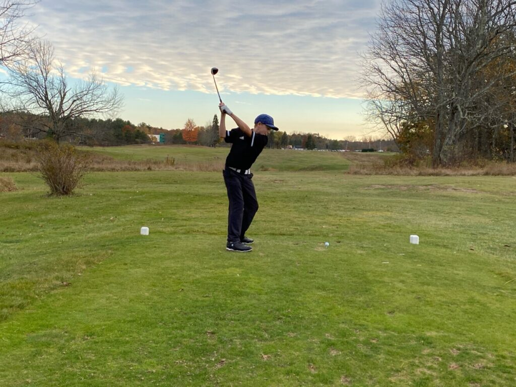 Eli Spaulding of Freeport gears up for a drive on the ninth hole during a match against Greely earlier this season at Freeport Country Club.