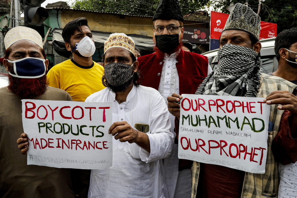 Muslim activists protest against France, near the French Consulate, in Kolkata, India, on Saturday. Muslims have been calling for both protests and a boycott of French goods in response to France's stance on caricatures of Islam's most revered prophet.
