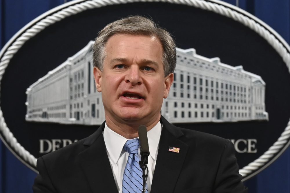 FBI Director Christopher Wray, shown in October, was among more than a dozen people whose images, home addresses and other personal information were posted on a website, Enemies of the People.