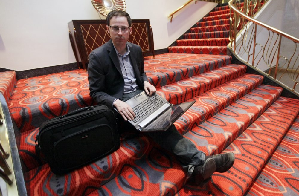 Nate Silver, statistician, unabashed numbers geek, author and creator of the much-read FiveThirtyEight, sits on the stairs at Allegro hotel in downtown Chicago.