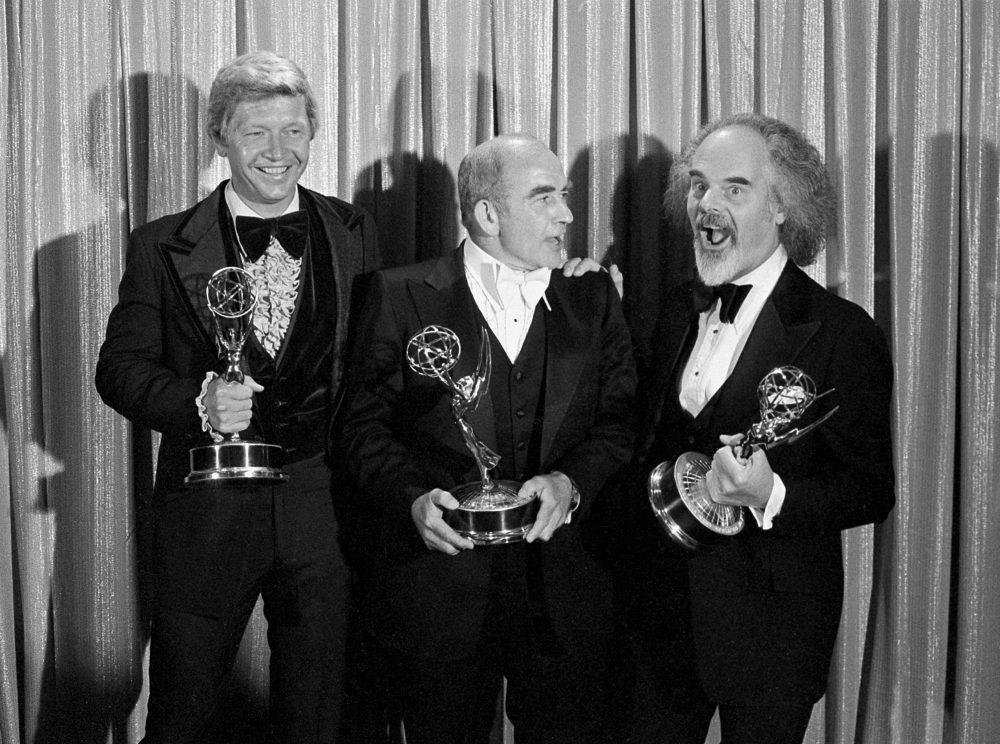 Screenwriter William Blinn, left, Ed Asner, center, and David Greene pose with their Emmy statuettes at the annual Primetime Emmy Awards presentation Sept. 11, 1977, in Los Angeles.