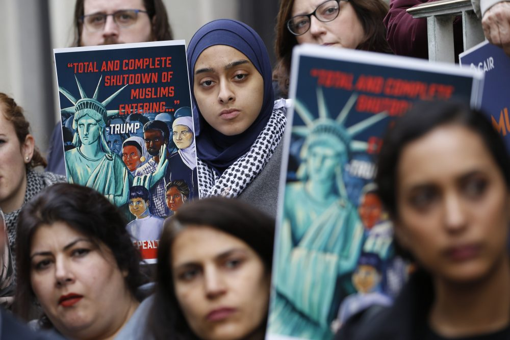 Demonstrators listen to speakers during a rally in support of refugees, outside the U.S. 4th Circuit Court of Appeals in Richmond, Va., in January.