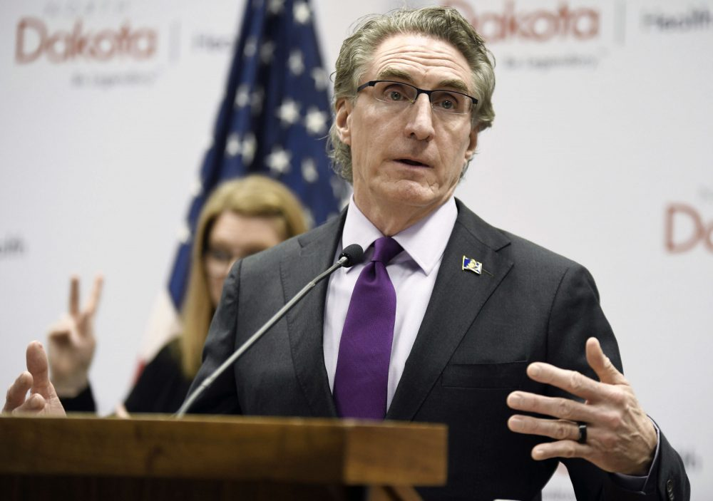 North Dakota Gov. Doug Burgum speaks at the state Capitol on April 10 in Bismarck, N.D. Hospitalizations from COVID-19 have hit their highest points recently throughout the Midwest, where the growth in new cases has been the worst in the nation. Doug Burgum, North Dakota's Republican governor, acknowledges his state's numbers are moving in the wrong direction as it hit new highs for active and newly confirmed cases, as well as hospitalizations. But he's also touting the state's test positivity staying in the 7 percent range.