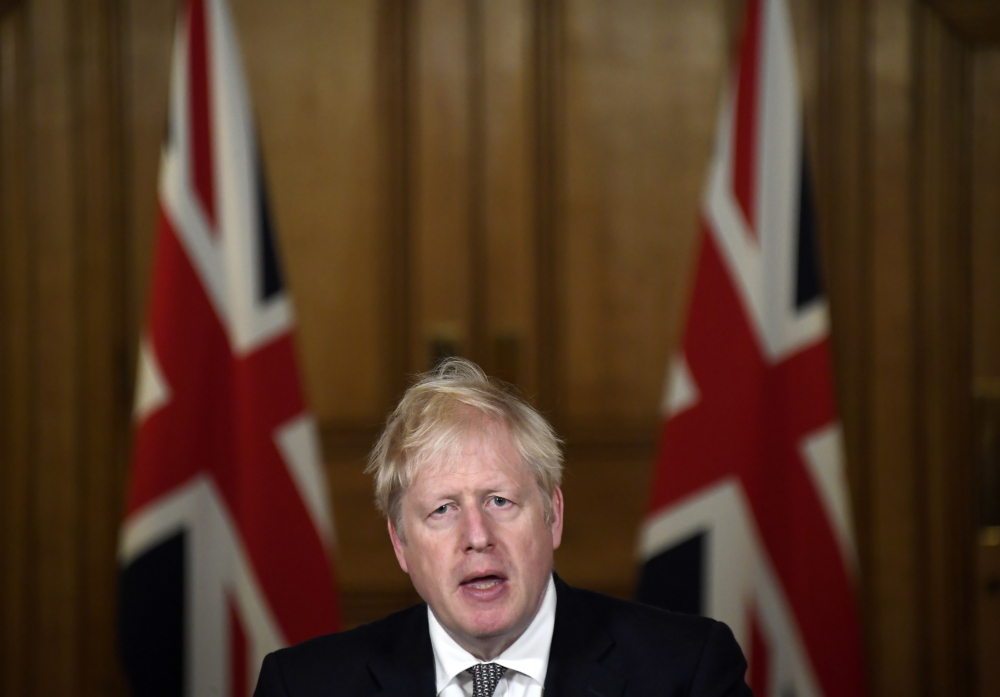 Britain's Prime Minister Boris Johnson speaks during a press conference in 10 Downing Street, London, on Saturday, where he announced new restrictions to help combat a coronavirus surge.