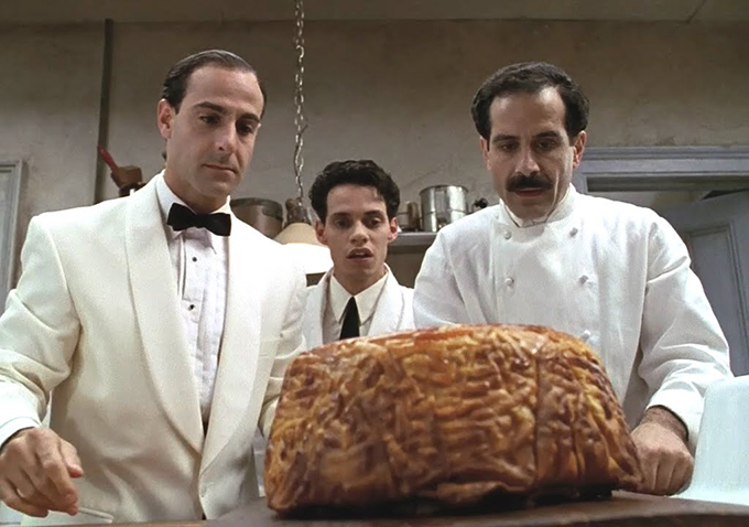 """Liev Schreiber, left, Marc Anthony and Tony Shalhoub in a scene from """"B ig Night""""."""