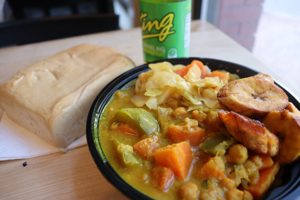 Yardie Ting's Coconut Curry plus two vegan sides, steamed vegetables and fried plantains.