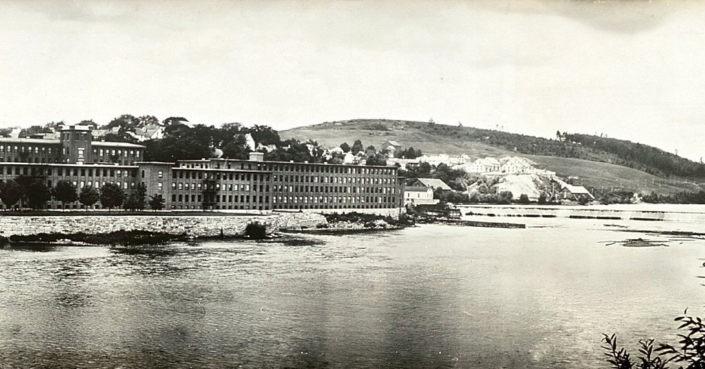 A partial view of the Edwards Manufacturing Company mill, left, and dam, right, on the banks of the Kennebec River in Augusta from 1910.