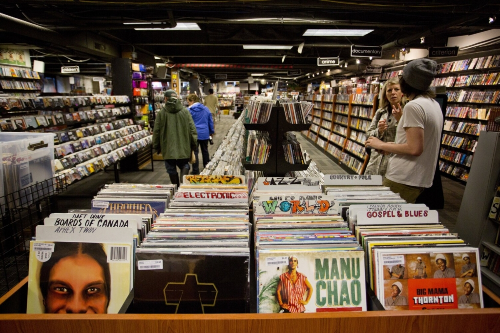 Customers browse at Bull Moose Music on Middle Street in Portland in June 2014. Bull Moose is closing its downtown Portland location.