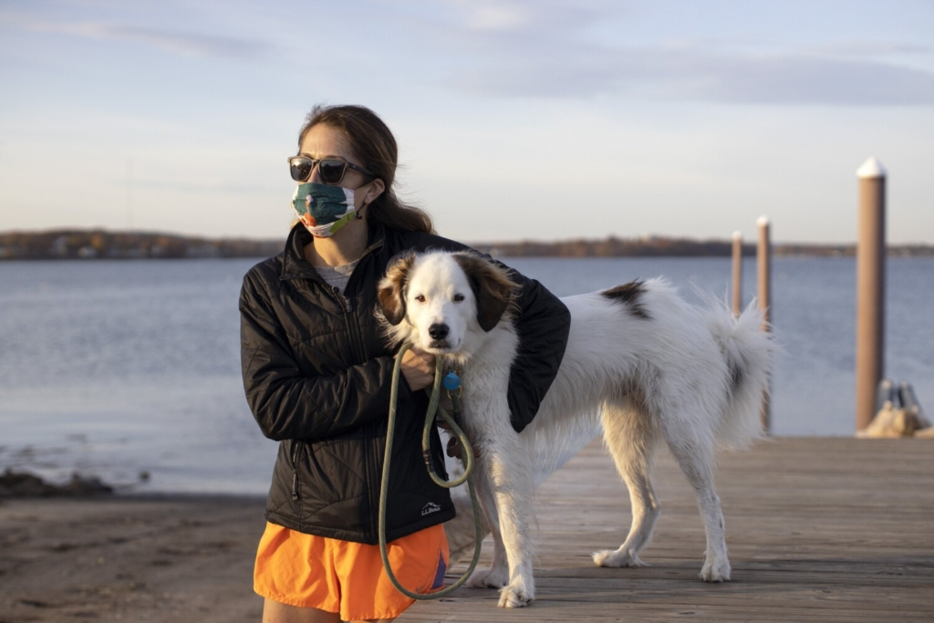 Kathleen Kramer, with  her dog, Blue, at Portland's East End Beach on Friday, said she didn't bring her mask when walking the dog in the past, but will now that masks are mandatory in all public places.