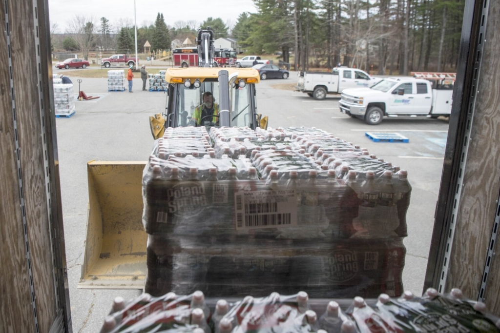 Cases of Poland Spring water are delivered in November in Skowhegan.