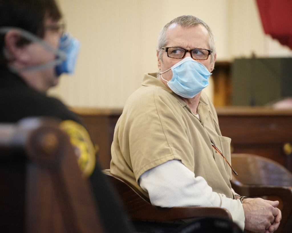 Bruce Akers looks to the seating area in the rear of the courtroom at York County Superior Court in Alfred at the start of his sentencing hearing Monday. Akers, who was found guilty of murdering his neighbor Douglas Flint in Limington with a machete in 2016, was sentenced to 38 years in prison by Justice Wayne Douglas.