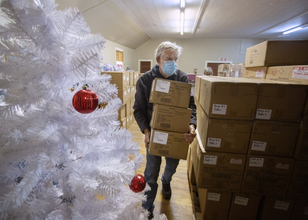 Carl Akin of Yarmouth helps organize boxes of toys for The Portland Press Herald Toy Fund earlier this month.