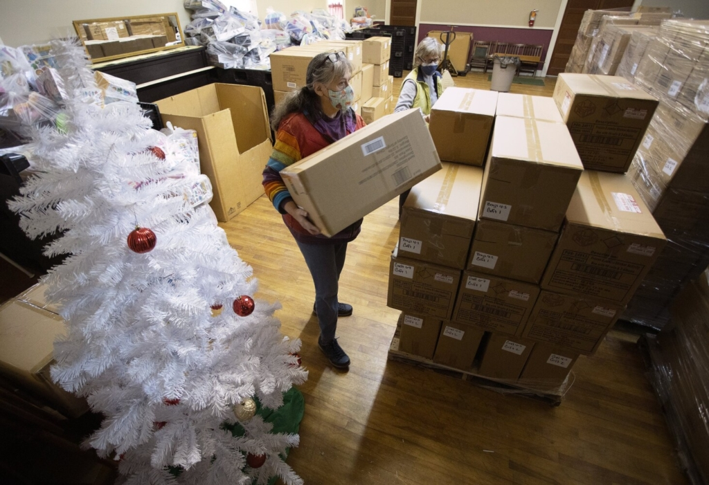 Kathleen Meade, left, and Julie Pew organize boxes of toys for The Portland Press Herald Toy Fund this month.