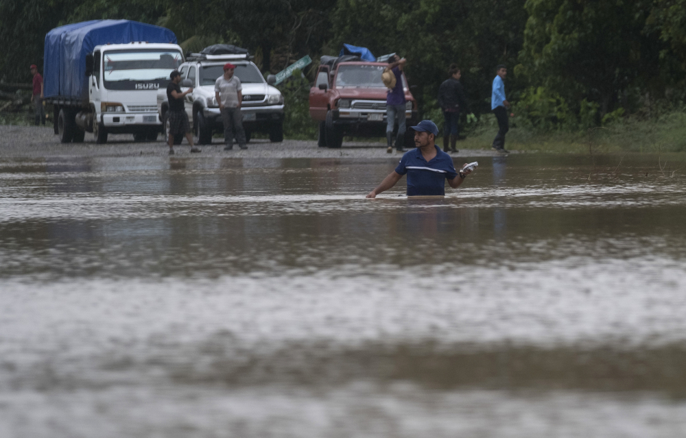 A man walks through a flooded road in Okonwas, Nicaragua, on Nov. 4.