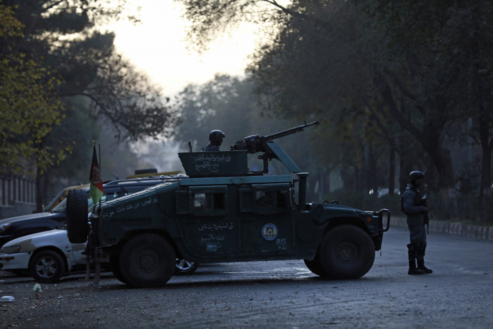 Afghan police patrol the site of an attack at Kabul University in Kabul, Afghanistan, on Monday.  The assault sparked a hours-long gun battle.