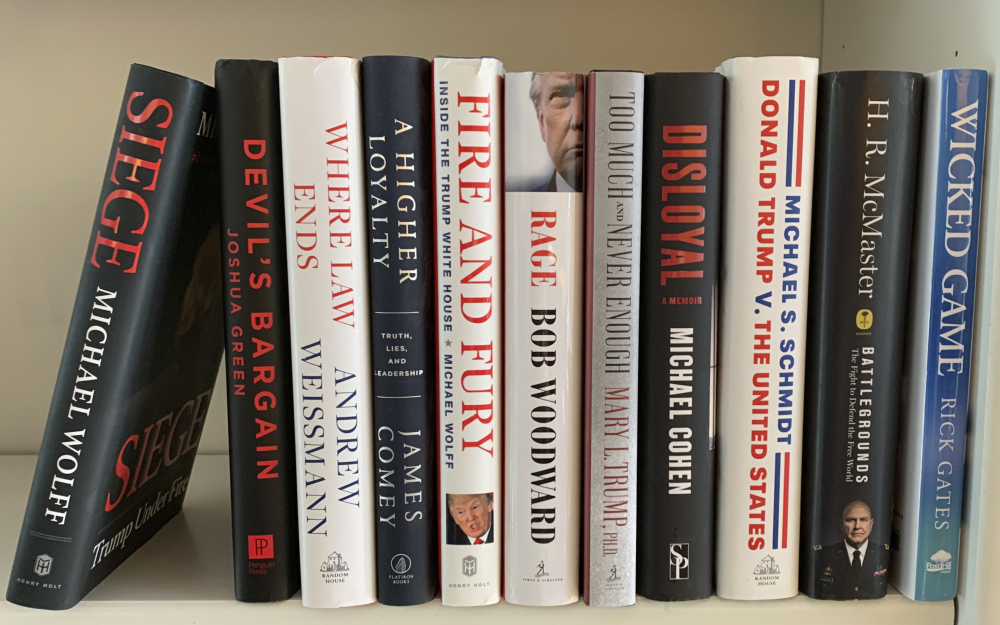 """A collection of books about President Donald Trump, from left, """"Siege"""" by Michael Wolff, """"Devil's Bargain"""" by Joshua Green, """"Where Law Ends"""" by Andrew Weissmann, """"A Higher Loyalty: Truth, Lies, and Leadership"""" by James Comey, """"Fire and Fury: Inside the Trump White House"""" by Michael Wolff, """"Rage"""" by Bob Woodward, """"Too Much and Never Enough"""" by Mary L. Trump, """"Disloyal"""" by Michael Cohen, """"Donald Trump V. The United States"""" by Michael S. Schmidt, """"Battlegrounds: The Fight to Defend the Free World"""" by H. R. McMaster and """"Wicked Game"""" by Rick Gates."""