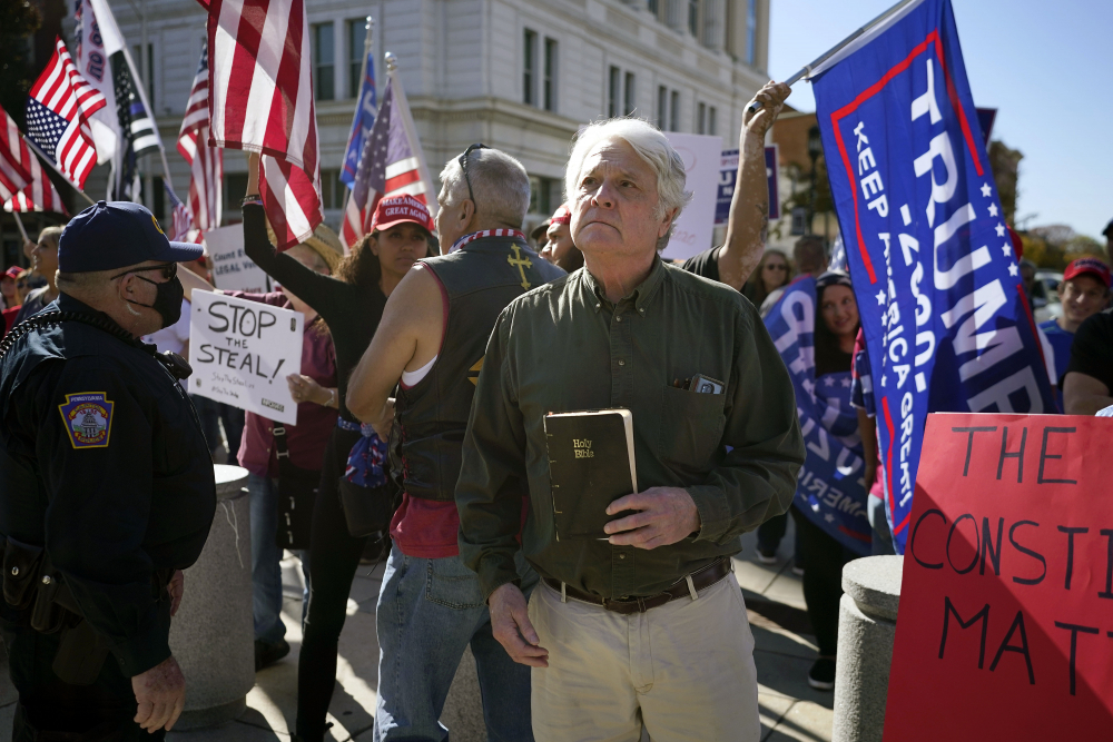 Supporters of President Trump demonstrate outside the Pennsylvania State Capitol, Saturday in Harrisburg, Pa., after Democrat Joe Biden defeated President Donald Trump to become 46th president of the United States.