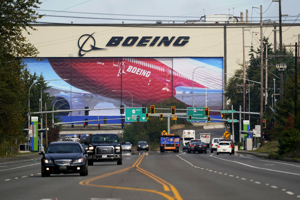 """Traffic passes the Boeing airplane production plant in Everett, Wash. An EU official said most European countries see President-elect Joe Biden's victory """"as an opportunity for us to take a new approach to our trade relationship ... with the U.S."""""""