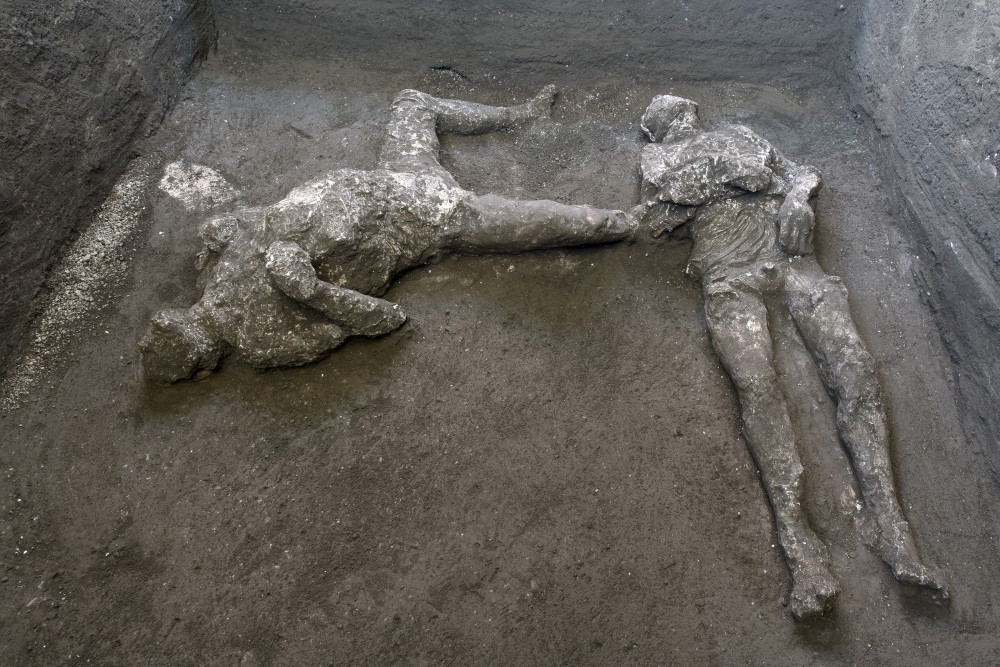 The casts of what are believed to have been a rich man and his male slave fleeing the volcanic eruption of Vesuvius nearly 2,000 years ago, are seen in what was an elegant villa on the outskirts of the ancient Roman city of Pompeii destroyed by the eruption in 79 A.D., where they were discovered during recent excavations, Pompeii archaeological park officials said Saturday,.