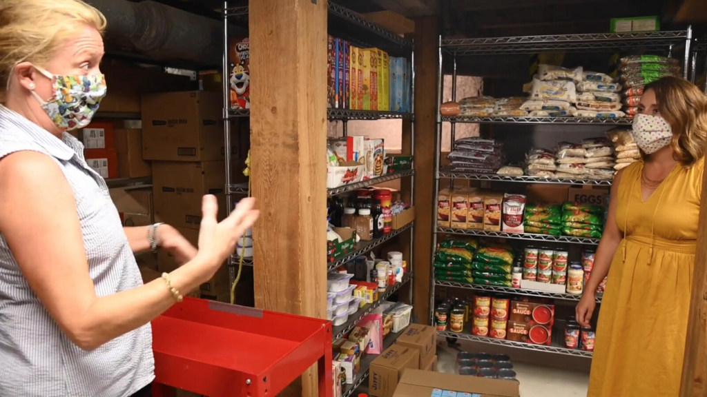 Jeanne Langsdorf, Hallowell Food Bank director, left, and Amy Marston, CMP Public Affairs manager.