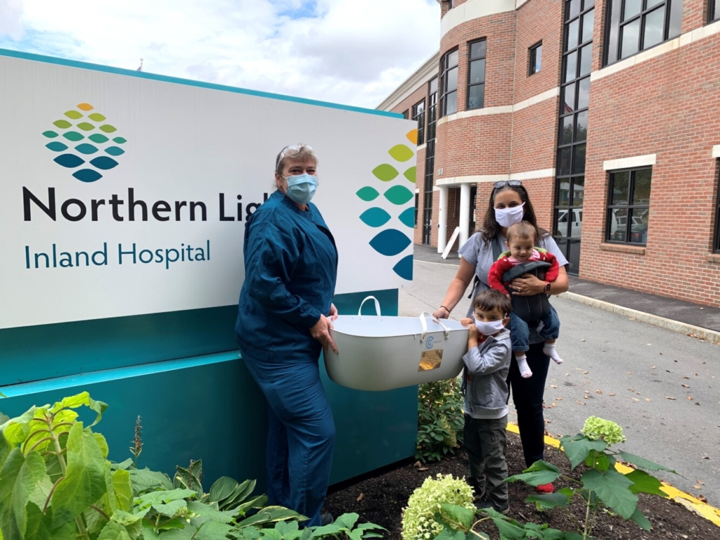Courtney Cook, RN, left, director of Northern Light Birthing at Inland Hospital in Waterville, with Amie Marzen,  right, president of Madeline's Mission with two of her children.