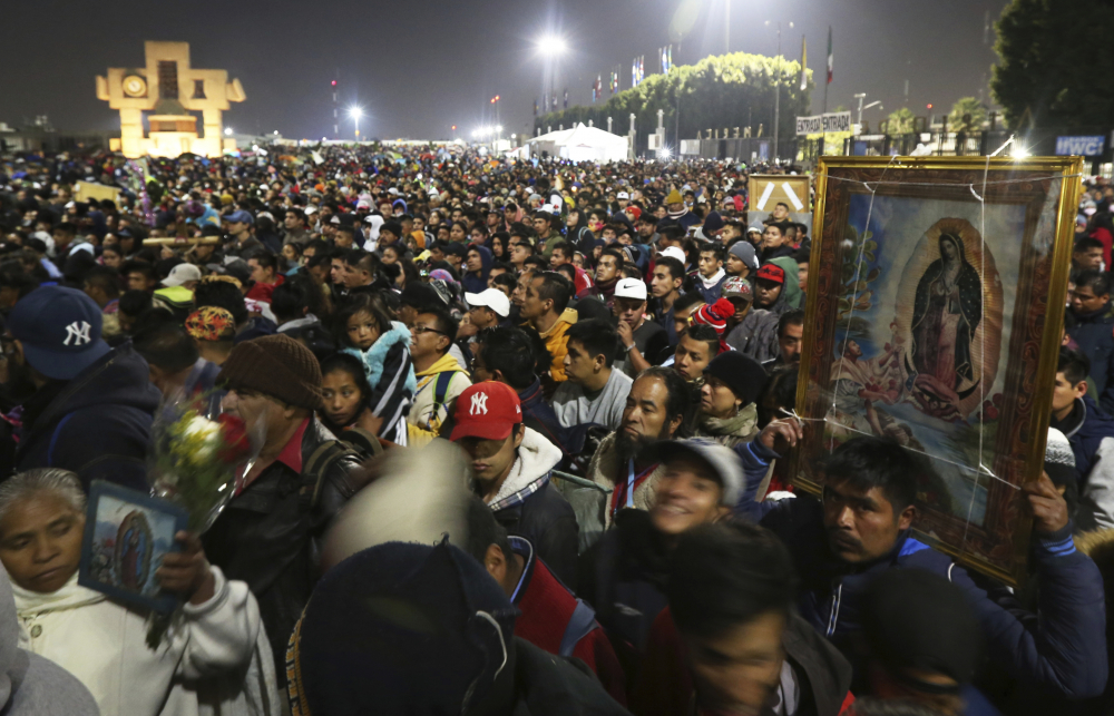 Pilgrims arrive at the plaza outside the Basilica of Our Lady of Guadalupe in Mexico City on Dec. 12, 2019. The annual gathering is the largest Catholic pilgrimage worldwide.