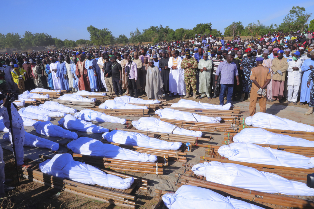 People attend a funeral for those killed by suspected Boko Haram militants in Zaabarmar, Nigeria, on Sunday.