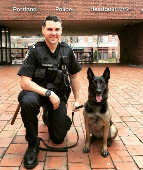Trixie with her handler, Officer Thomas Reagan