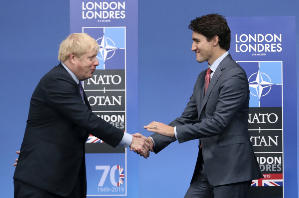 British Prime Minister Boris Johnson, left, welcomes Canadian Prime Minister Justin Trudeau Dec. 4 for a NATO leaders meeting in Watford, Hertfordshire, England.