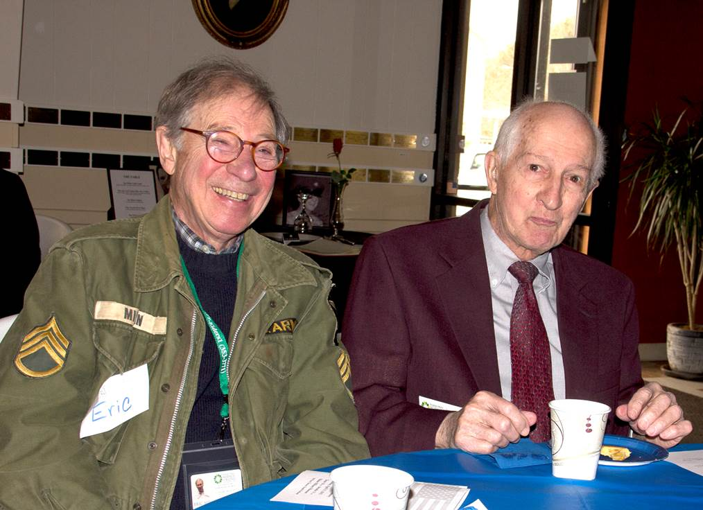 Eric Mihan, left, and Vernon Huestis, right, at a Vet to Vet Honors Ceremony in 2015 at the Maine Military Museum in South Portland.