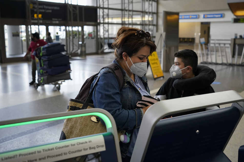 Esmeralda Elizalde checks in for her flight to Mexico at the Los Angeles International Airport on Monday.